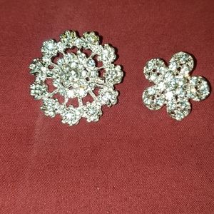 Two brooches silver and rhinestones